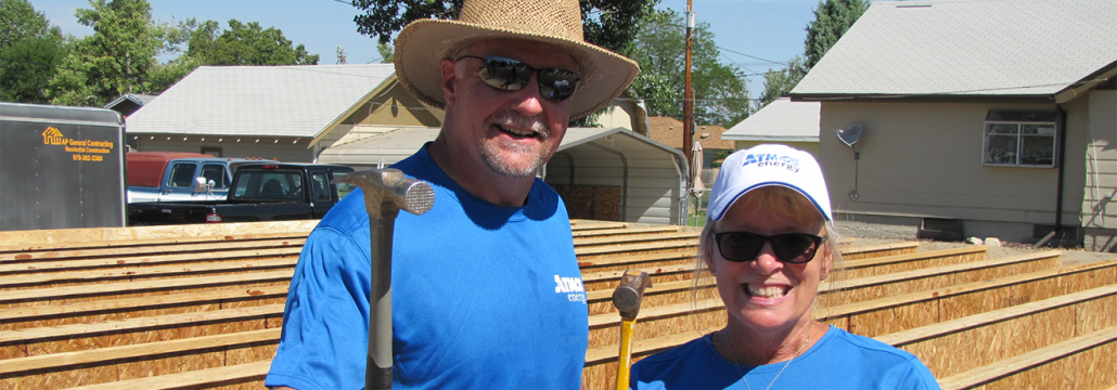 Atmos Energy Employees Holding Hammers Ready to Build a Habitat House