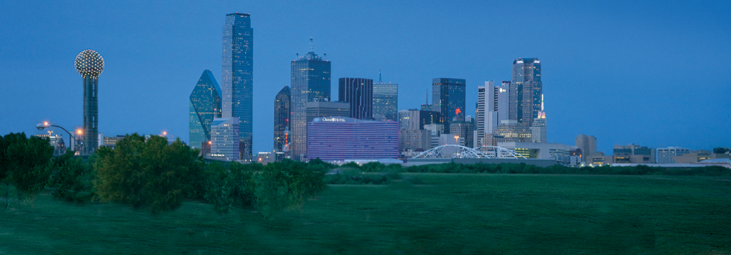 Photograph of the skyline of downtown Dallas, Texas at dusk.