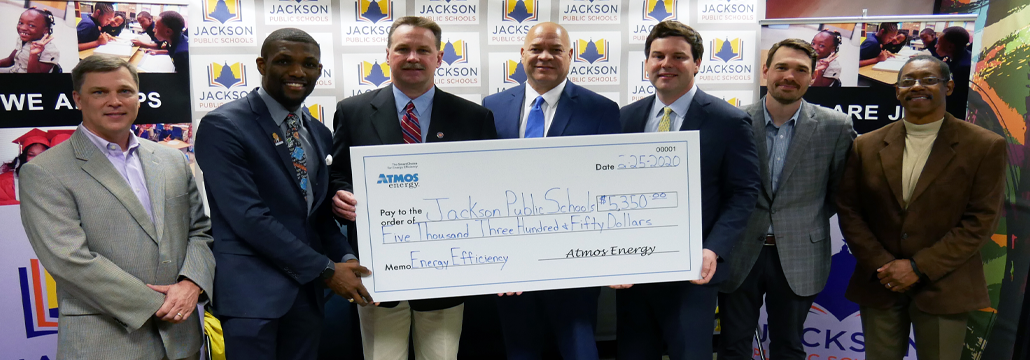 Commissioner Brent Bailey & Atmos Energy present check to Jackson Public Schools