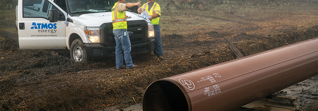 Atmos Energy personnel installing pipe as part of our safe and reliable system.