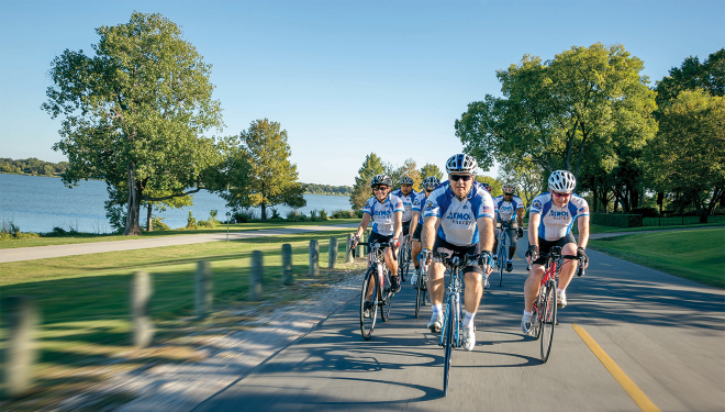 Atmos Energy employees riding in a bike race to raise money for multiple sclerosis