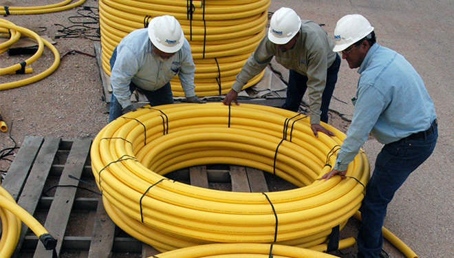 Atmos Energy Employees with Yellow Pipe